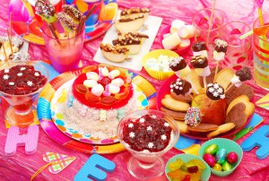 birthday party with homemade torte and fruit sweets for children